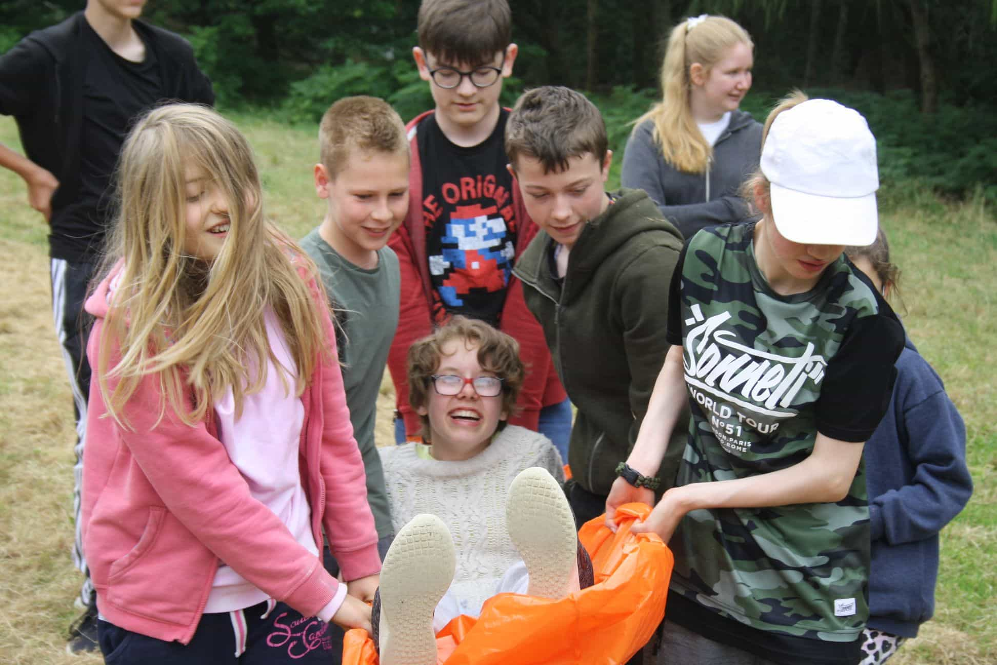 LVS Oxford student Leila is carried on a makeshift stretcher by classmates in a survival exercise