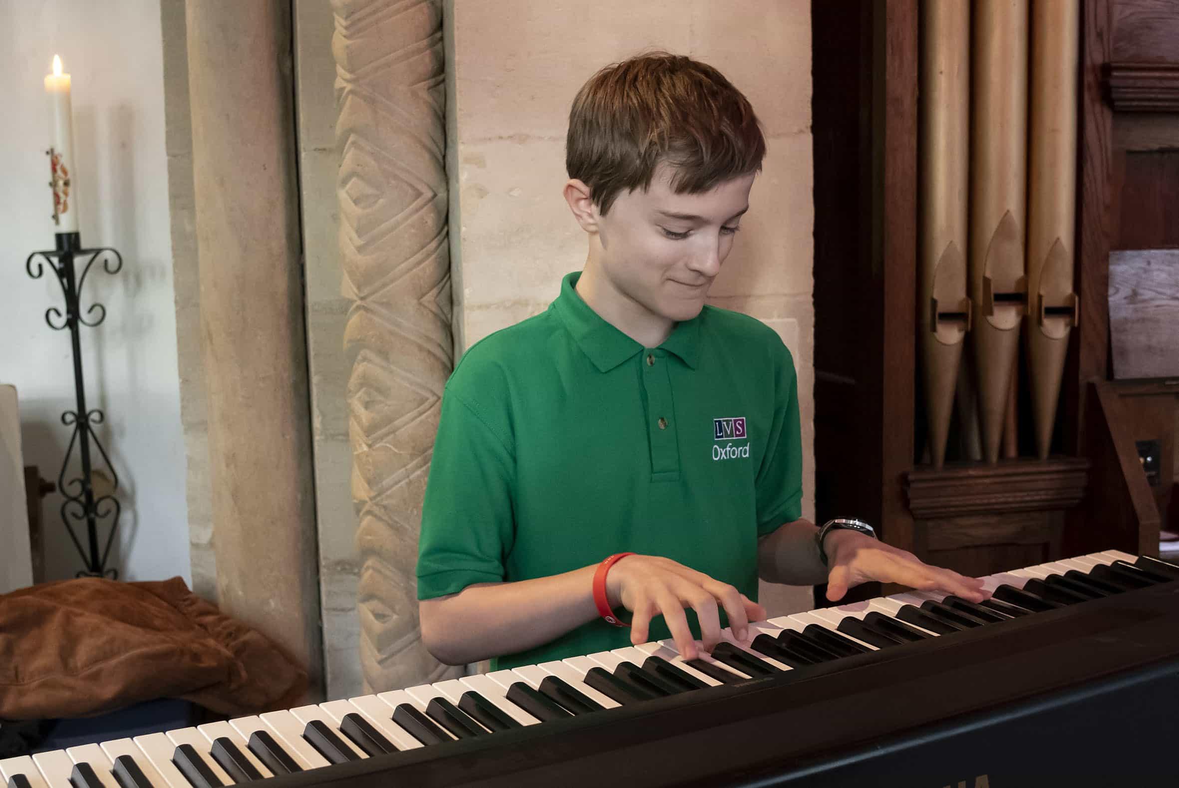 pupil playing piano