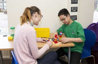 pupil playing with Lego in therapy session